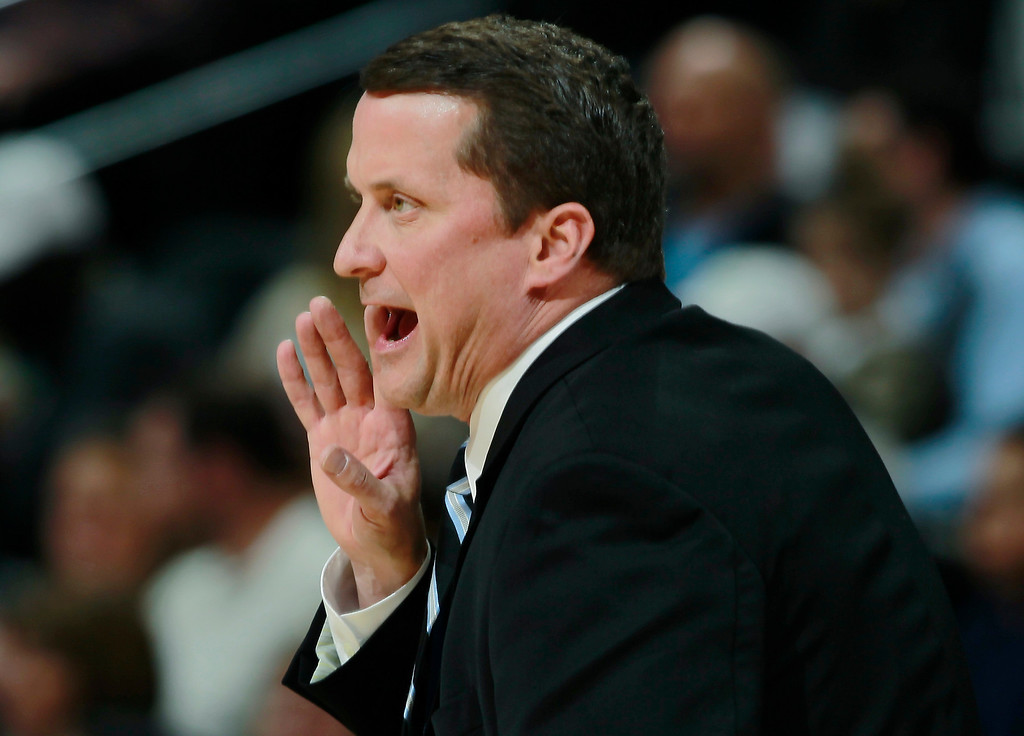 . Detroit Pistons head coach John Loyer directs his team against the Denver Nuggets in the first quarter of an NBA basketball game in Denver on Wednesday, March 19, 2014. (AP Photo/David Zalubowski)