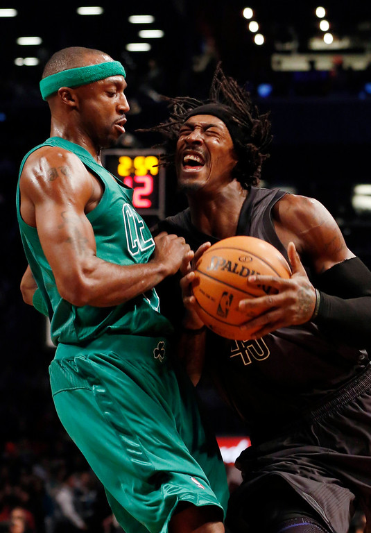 . Brooklyn Nets forward Gerald Wallace (45) drives against Boston Celtics guard Jason Terry (4) in the first half of their NBA basketball game at the Barclays Center, Tuesday, Dec. 25, 2012, in New York. (AP Photo/John Minchillo)