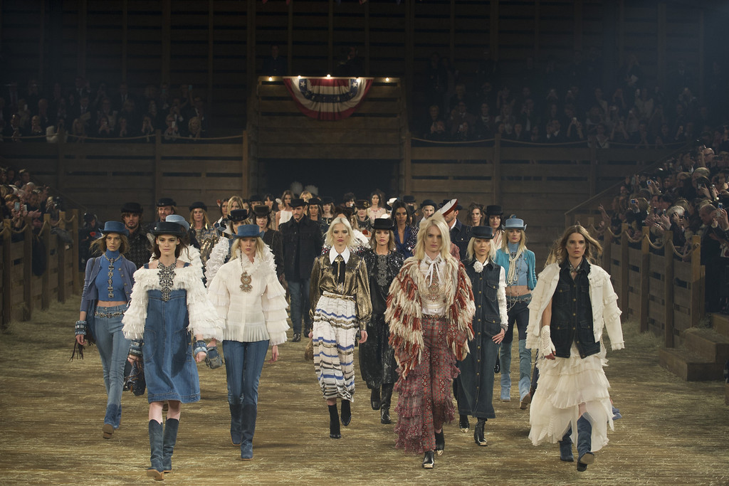 ". Models walk the runway during the Chanel ""Metiers d\'Art\"" Show at Fair Park on December 10, 2013 in Dallas, Texas.  (Photo by Cooper Neill/Getty Images for Chanel)"