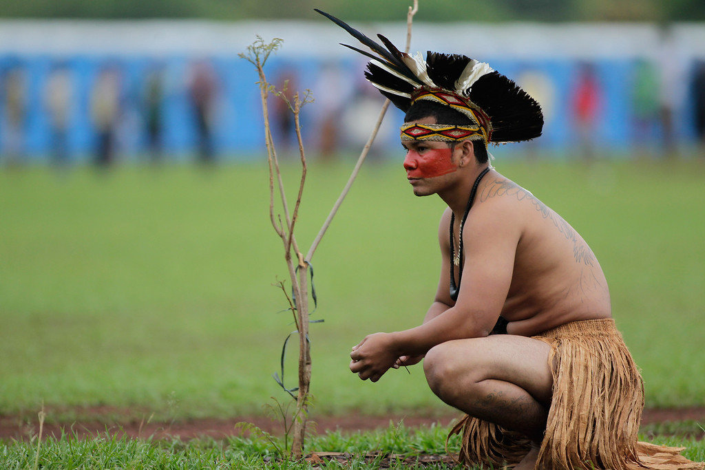 . A Pataxo Indian rests during the first day of the National Indigenous Mobilization protest in Brasilia, Brazil, Tuesday, Oct. 1, 2013.  (AP Photo/Eraldo Peres)