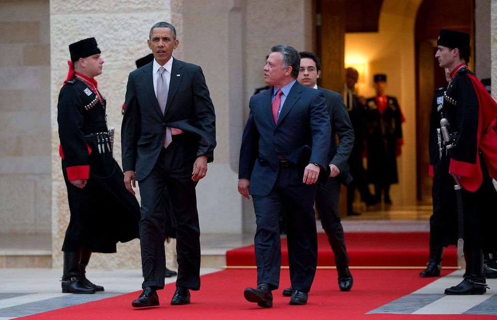 . President Barack Obama walks with Jordan\'s King Abdullah II to participate in an official arrival ceremony, Friday, March 22, 2013, at Al-Hummar Palace, the residence of Jordanian King Abdullah II, in Amman, Jordan. (AP Photo/Carolyn Kaster)