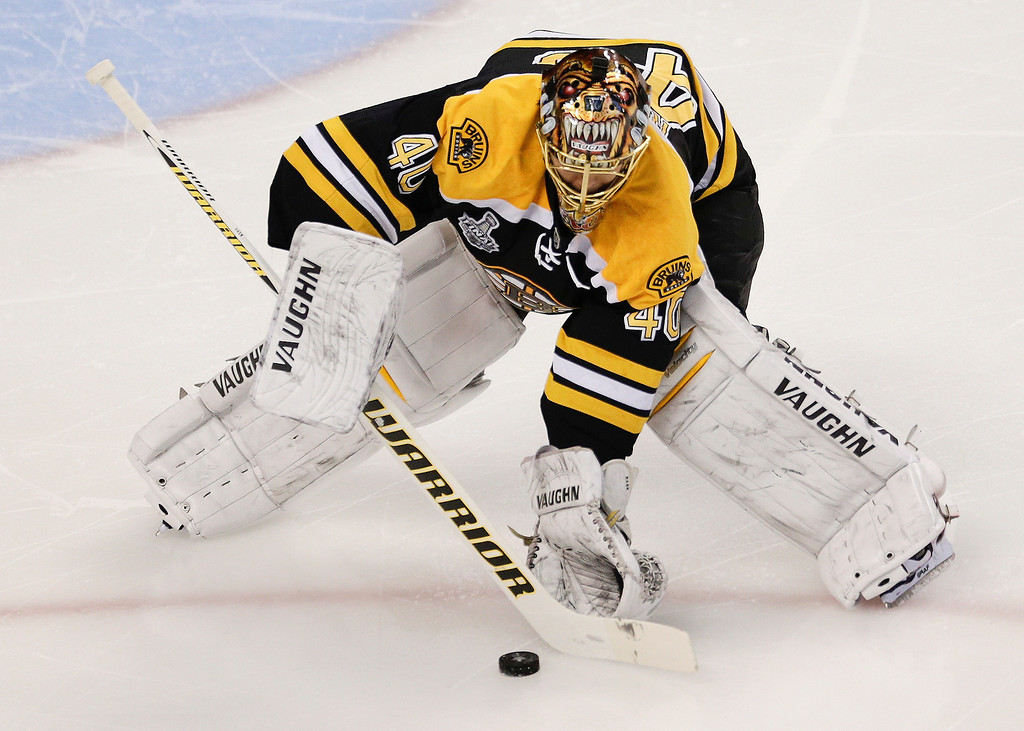 . Boston Bruins goalie Tuukka Rask, of Finland, handles the puck against the Chicago Blackhawks during the first period in Game 6 of the NHL hockey Stanley Cup Finals, Monday, June 24, 2013, in Boston. (AP Photo/Charles Krupa)