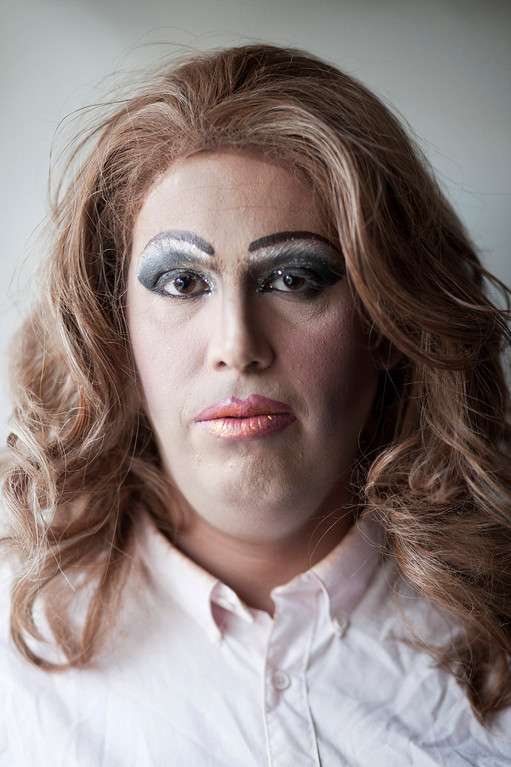. Israeli Orthodox Jew Shahar Hadar poses in full makeup as he prepares for a show at a drag queen school in downtown Tel Aviv, Israel on Tuesday, June 18, 2013. Hadar, a telemarketer by day, has taken the gay Orthodox struggle from the synagogue to the stage, beginning to perform as one of Israel\'s few religious drag queens. His drag persona is that of a rebbetzin, a female rabbinic advisor, a wholesome guise that stands out among the sarcastic and raunchy cast of characters on Israel\'s drag queen circuit. (AP Photo/Oded Balilty)