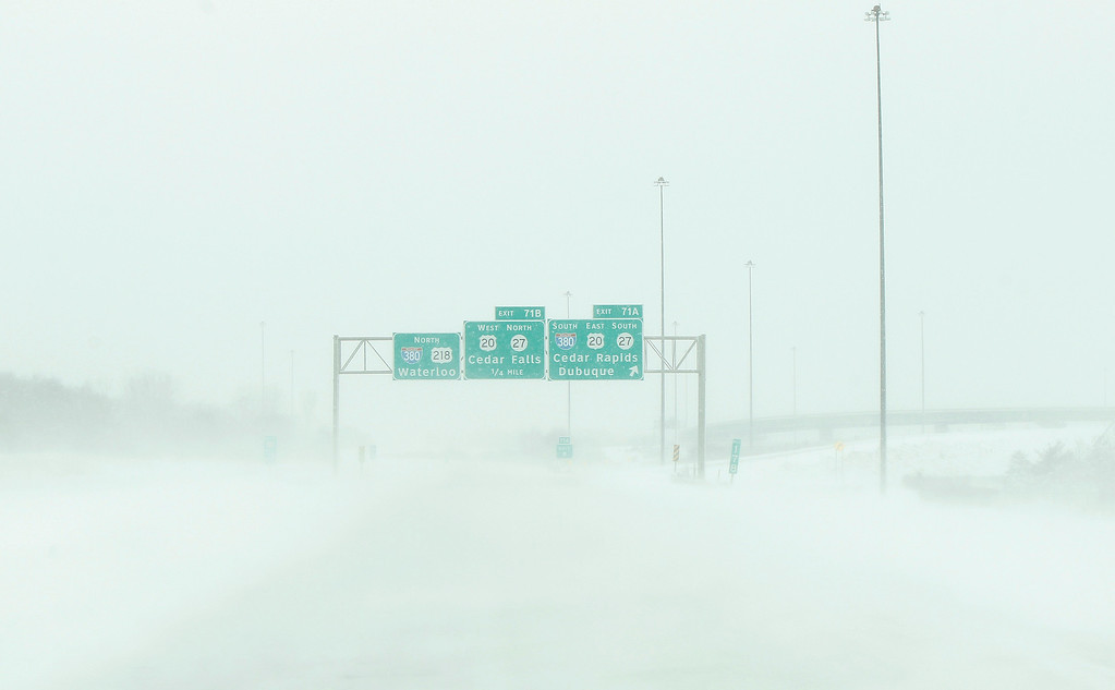 . Snow blows across US Highway 218 as near whiteout conditions begin in Waterloo, Iowa, December 20, 2012. The first major winter storm of the year took aim at the U.S. Midwest on Thursday, triggering high wind and blizzard warnings across a widespread area, and a threat of tornadoes in Gulf Coast states to the south. REUTERS/Matthew Putney/The Waterloo Courier/Handout