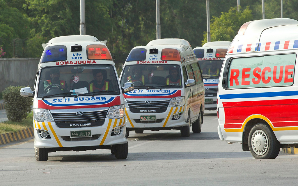 . Ambulances carry the bodies of foreign tourists killed by unidentified gunmen near the Nanga Parbat peak, after they are brought to a military base in Rawalpindi June 23, 2013. Gunmen stormed a mountaineering base camp in northern Pakistan on Sunday and shot dead nine foreign trekkers and a Pakistani guide as they rested during an arduous climb up one of the world\'s tallest peaks, police said. REUTERS/Mian Khursheed