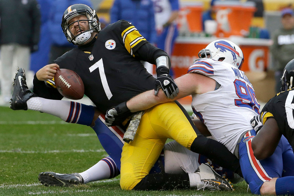. Pittsburgh Steelers\' Ben Roethlisberger, left, has the ball knocked loose as he is tackled by Buffalo Bills\' Kyle Williams, right, during the first half of an NFL football game, Sunday, Nov. 10, 2013, in Pittsburgh. (AP Photo/Gene J. Puskar)