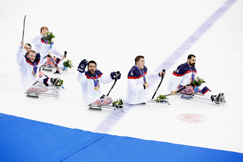 . Members of the USA team celebrate winning the Ice Sledge Hockey Gold Medal match between Russia and USA at the Shayba Arena during day eight of the 2014 Paralympic Winter Games on March 15, 2014 in Sochi, Russia.  (Photo by Harry Engels/Getty Images)