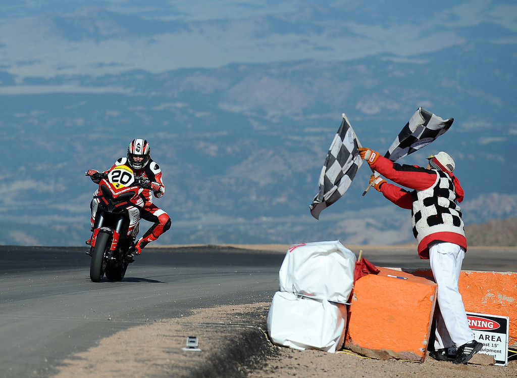 . Bruno Langlois, of France, rider of the #20 Ducati Multistrada, crosses the finish line to win the bike division during the Pikes Peak International Hill Climb on June 30, 2013 in Colorado Springs, Colorado. (Photo by Rainier Ehrhardt/Getty Images)