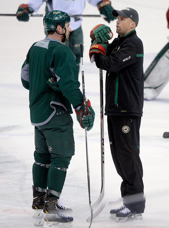. Minnesota Wild coach Mike Yeo talked with defenseman Keith Ballard during practice Wednesday morning in St. Paul.  The Minnesota Wild defeated the Colorado Avalanche 1-0 in overtime at the Xcel Energy Center in St. Paul Monday night, April 21, 2014. (Photo by Karl Gehring/The Denver Post)