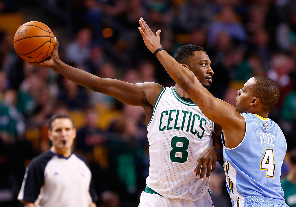 . BOSTON, MA - DECEMBER 06: Jeff Green #8 of the Boston Celtics holds the ball in front of Randy Foye #4 of the Denver Nuggets in the second half during the game at TD Garden on December 6, 2013 in Boston, Massachusetts.  (Photo by Jared Wickerham/Getty Images)