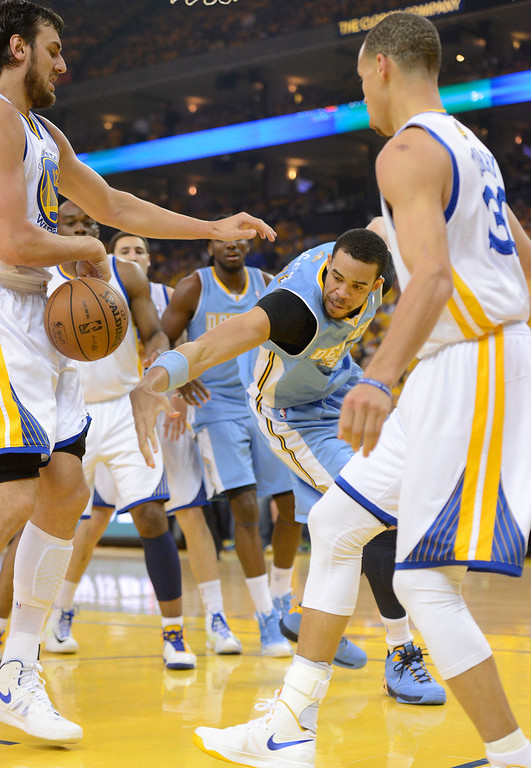 . JaVale McGee (34) of the Denver Nuggets scrambles for the ball with Andrew Bogut (12) of the Golden State Warriors during the first quarter in Game 6 of the first round NBA Playoffs May 2, 2013 at Oracle Arena. (Photo By John Leyba/The Denver Post)