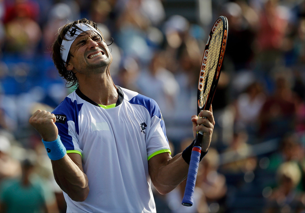 . David Ferrer, of Spain, reacts after beating Roberto Bautista Agut, also of Spain, during the second round of the 2013 U.S. Open tennis tournament, Thursday, Aug. 29, 2013, in New York. (AP Photo/David Goldman)