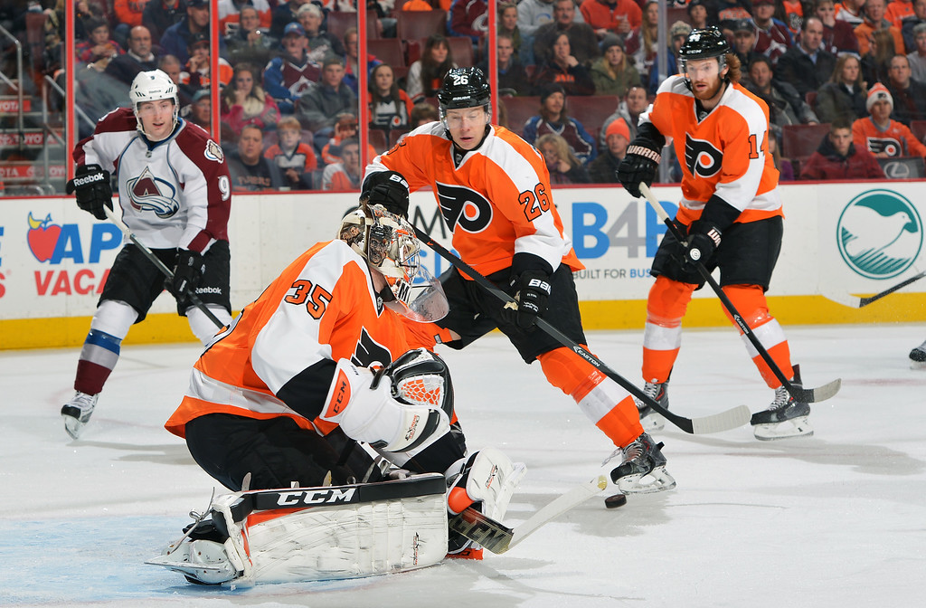 . PHILADELPHIA, PA - FEBRUARY 06:  Steve Mason #35 of the Philadelphia Flyers makes a save in front of Erik Gustafsson #26, Sean Couturier #14 and Matt Duchene #9 of the Colorado Avalanche at the Wells Fargo Center on February 6, 2014 in Philadelphia, Pennsylvania.  (Photo by Drew Hallowell/Getty Images)