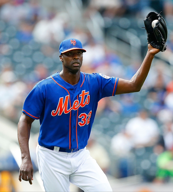 . LaTroy Hawkins #32 of the New York Mets fields the ball for the final out of a game against the Colorado Rockies at Citi Field on August 8, 2013 in the Flushing neighborhood of the Queens borough of New York City. The Mets defeated the Rockies 2-1.  (Photo by Jim McIsaac/Getty Images)