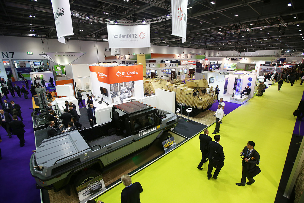 . Visitors walk past amphibious vehicles displayed at the Defense and Security Exhibition on September 10, 2013 in London, England.  (Photo by Peter Macdiarmid/Getty Images)
