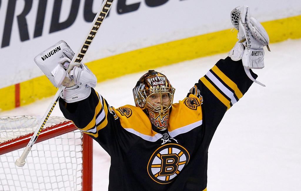. Boston Bruins goalie Tuukka Rask celebrates after the Bruins defeated the Pittsburgh Penguins to win Game 4 of their NHL Eastern Conference finals hockey playoff series in Boston, Massachusetts, June 7, 2013. REUTERS/Brian Snyder