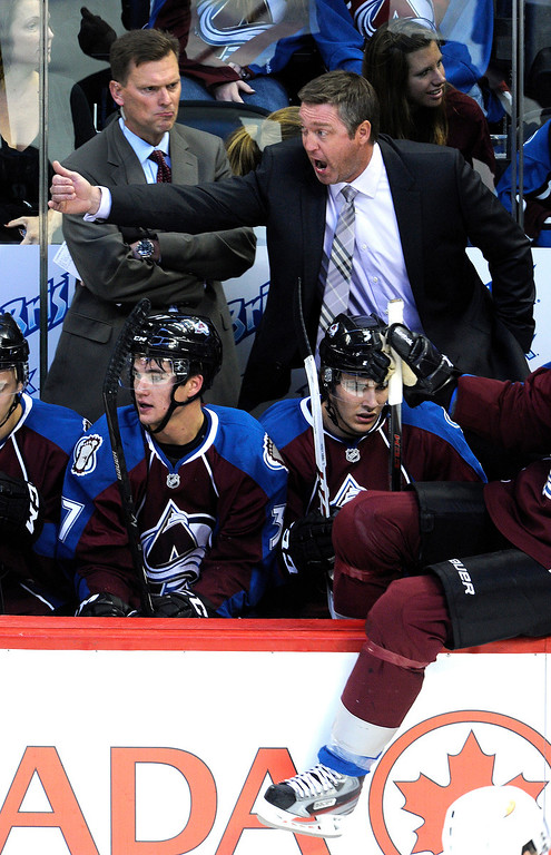 . Colorado coach Patrick Roy yelled instructions to the team in his first game for the Avalanche Wednesday night. Assistant coach Tim Army is at left.   Photo By Karl Gehring/The Denver Post