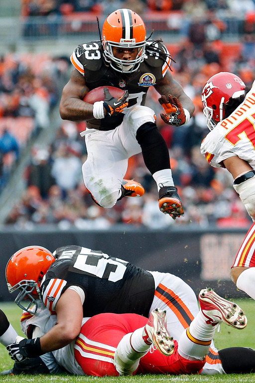 . Cleveland Browns running back Trent Richardson (33) leaps over the line during the third quarter of an NFL football game against the Kansas City Chiefs, Sunday, Dec. 9, 2012, in Cleveland. (AP Photo/Rick Osentoski)