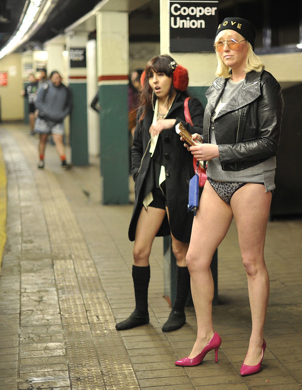 . Riders wait for a train in the New York subway in their underwear as they take part in the 2014 No Pants Subway Ride on January 12, 2014. Started by Improv Everywhere, the goal is for riders to get on the subway train dressed in normal winter clothes without pants and keep a straight face.   TIMOTHY A. CLARY/AFP/Getty Images