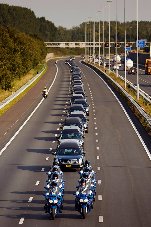 . A convoy of hearses bearing the remains of passengers and crew killed in the downing of Malaysia Airlines Flight 17 makes its way along a highway near Boxtel, Netherlands, Thursday, July 24, 2014. The second flight of two military aircraft carrying remains of victims arrived in the Netherlands on Thursday. The bodies are to be taken to a military barracks in Hilversum, where a team of 25 forensic experts and dozens of support staff began working to identify remains Wednesday evening after coffins of the first flight arrived. (AP Photo/Phil Nijhuis)