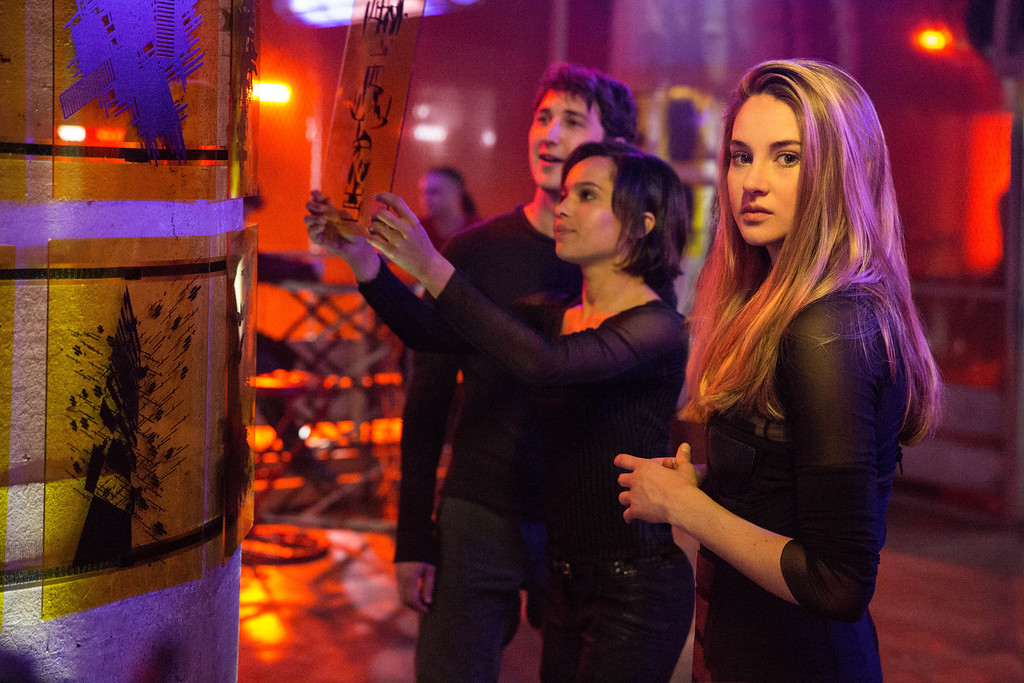. (L-R) BEN LLOYD HUGHES, ZOE KRAVITZ, and SHAILENE WOODLEY star in DIVERGENT