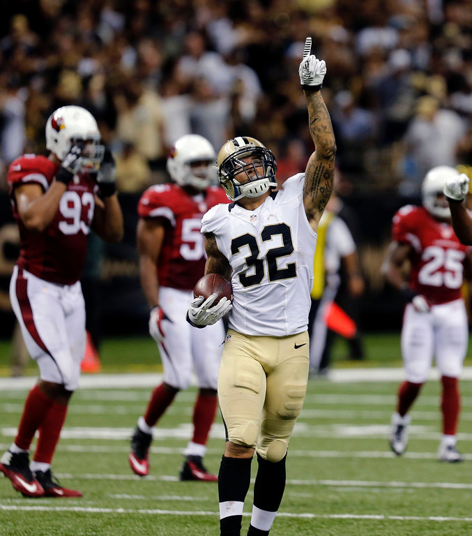 . New Orleans Saints strong safety Kenny Vaccaro (32) celebrates his interception in the second half of an NFL football game against the Arizona Cardinals in New Orleans, Sunday, Sept. 22, 2013. (AP Photo/Bill Haber)