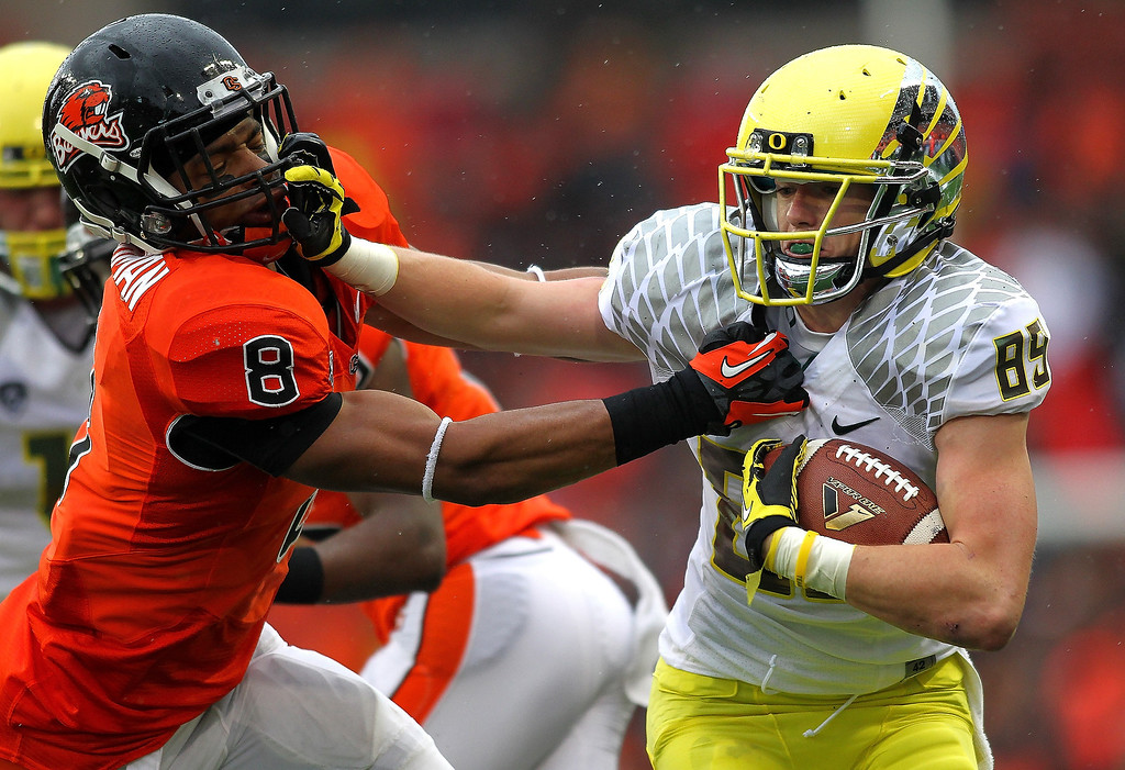 . Will Murphy #89 of the Oregon Ducks stif arms Tyrequek Zimmerman #8 of the Oregon State Beavers during the 116th Civil War on November 24, 2012 at the Reser Stadium in Corvallis, Oregon.  (Photo by Jonathan Ferrey/Getty Images)