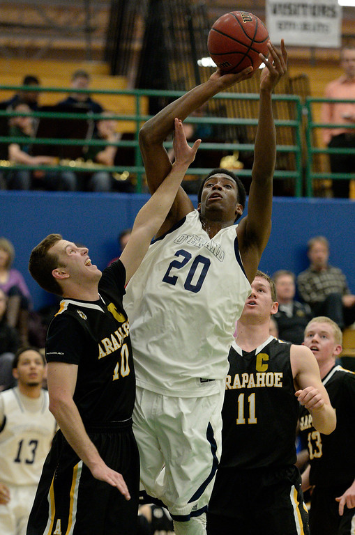 . AURORA, CO - FEBRUARY 12: Overland De\'Ron Davis (20) takes a shot over Arapahoe Corbin Atwell (10) during their 5A basketball game February 12, 2014 in Aurora. Overland defeated Arapahoe 72-65. (Photo by John Leyba/The Denver Post)