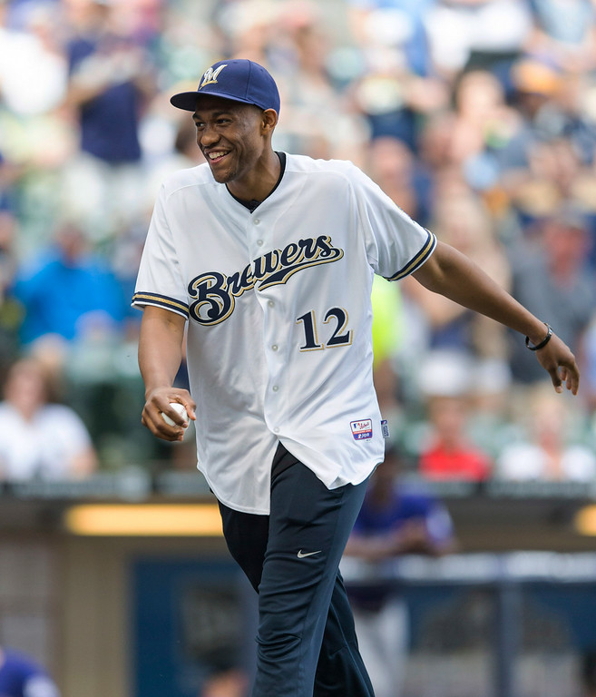. Jabari Parker, of the Milwaukee Bucks, and the number 2 overall pick in the NBA draft throws out the ceremonial first pitch before the start of the Milwaukee Brewers\' and Colorado Rockies\' baseball game Saturday, June 28, 2014, in Milwaukee. (AP Photo/Tom Lynn)