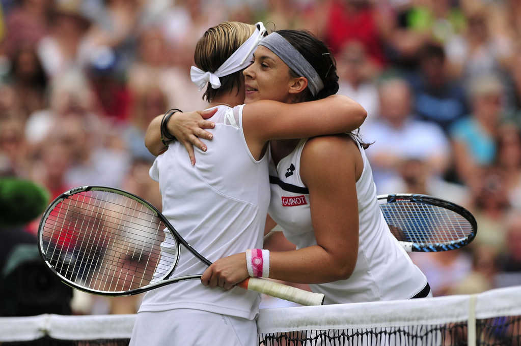 . France\'s Marion Bartoli (R) embraces Belgium\'s Kirsten Flipkens (L) after Bartoli won their women\'s singles semi-final match on day ten of the 2013 Wimbledon Championships tennis tournament at the All England Club in Wimbledon, southwest London, on July 4, 2013. Bartoli won 6-1, 6-2. GLYN KIRK/AFP/Getty Images