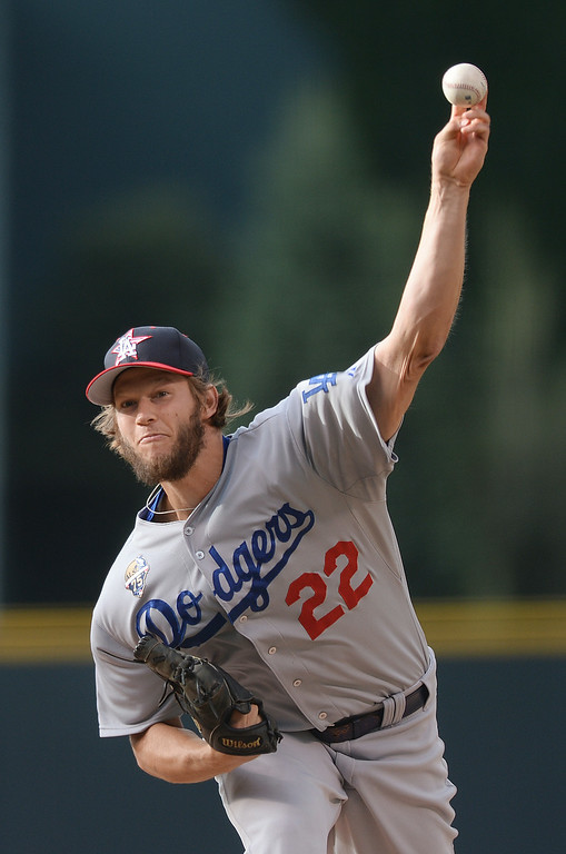 . DENVER, CO - JULY 4: Dodgers pitcher Clayton Kershaw delivered to the plate in the first inning. The Colorado Rockies hosted the Los Angeles Dodgers at Coors Field Friday night, July 4, 2014.  Photo by Karl Gehring/The Denver Post