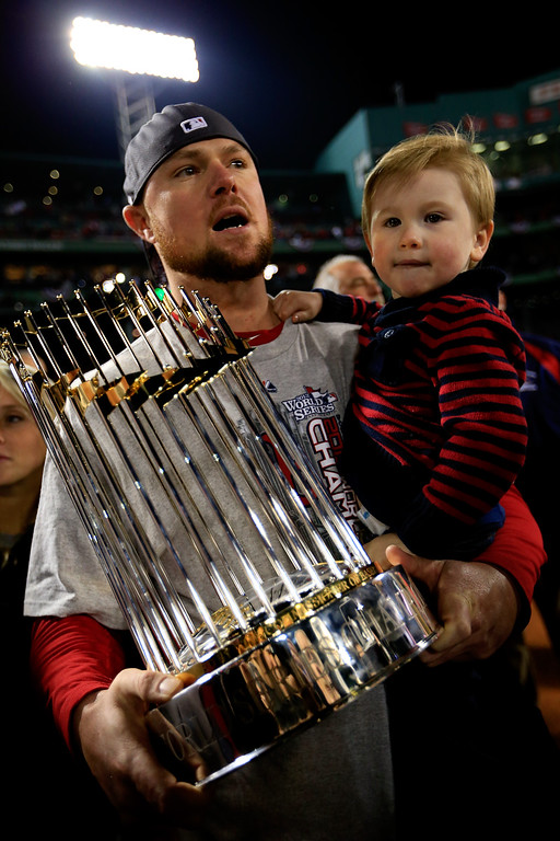 . Jon Lester #31 of the Boston Red Sox celebrates with his son Hudson after defeating the St. Louis Cardinals 6-1 in Game Six of the 2013 World Series at Fenway Park on October 30, 2013 in Boston, Massachusetts.  (Photo by Jamie Squire/Getty Images)
