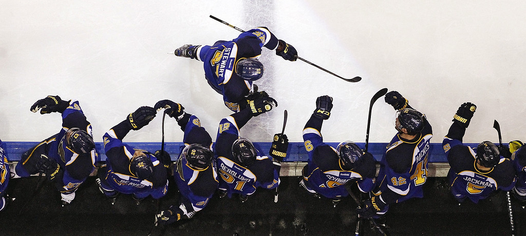 . St. Louis Blues right wing Chris Stewart is congratulated after scoring against the Colorado Avalanche during the first period of their NHL hockey game, Tuesday, April 23, 2013, in St. Louis. The Blues won 3-1. (AP Photo/St. Louis Post-Dispatch, Chris Lee)