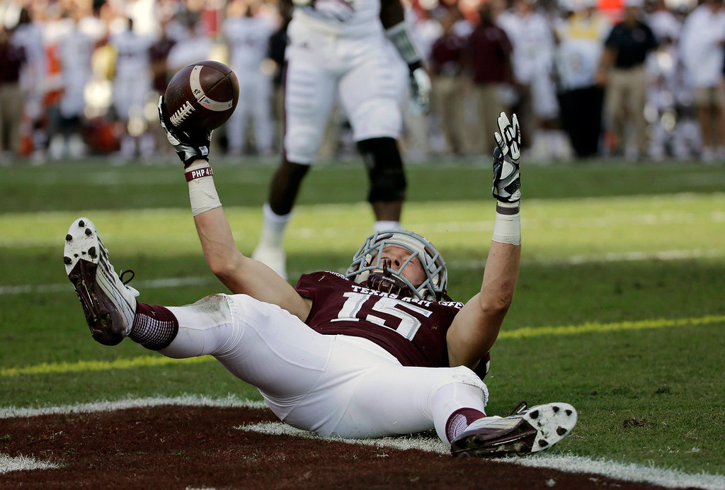 . Texas A&M wide receiver Travis Labhart celebrates after catching a touchdown pass against Mississippi State during the first quarter of an NCAA college football game Saturday, Nov. 9, 2013, in College Station, Texas. (AP Photo/David J. Phillip)