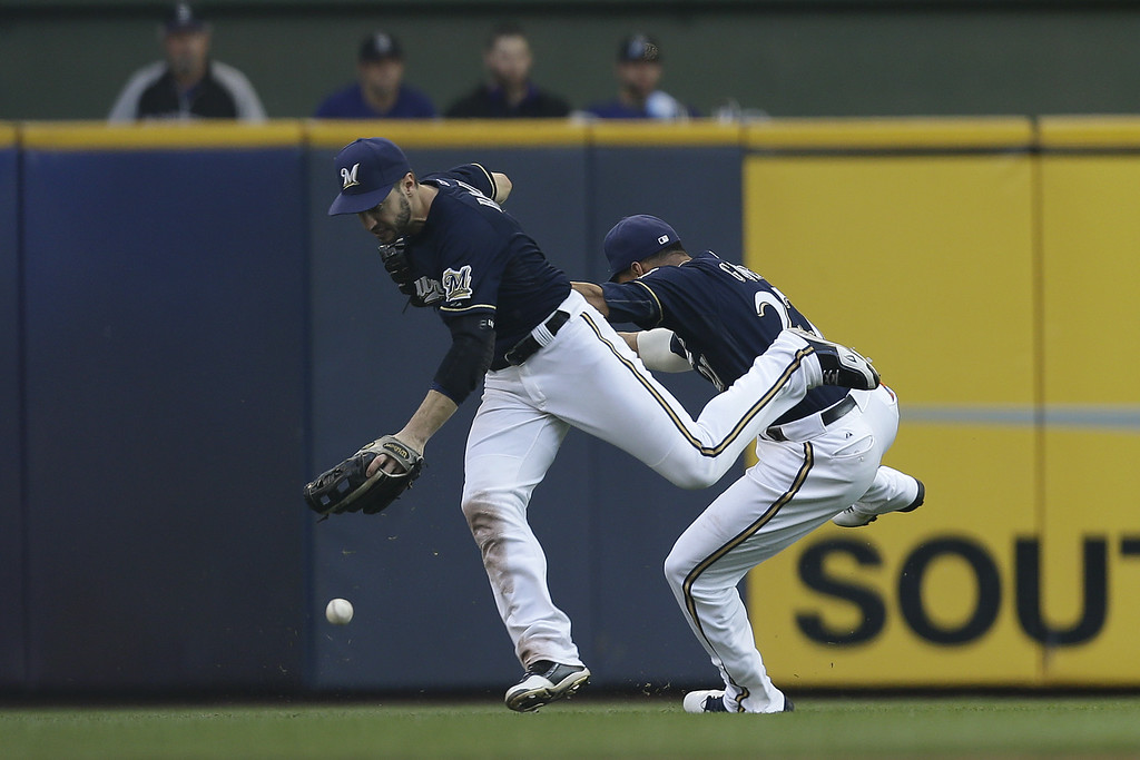 . MILWAUKEE, WI - JUNE 28: Ryan Braun #8 of the Milwaukee Brewers collides with Carlos Gomez #27 after missing this catch in left field allowing Ryan Wheeler #44 of the Colorado Rockies a double in the top of the seventh inning at Miller Park on June 28, 2014 in Milwaukee, Wisconsin. (Photo by Mike McGinnis/Getty Images)