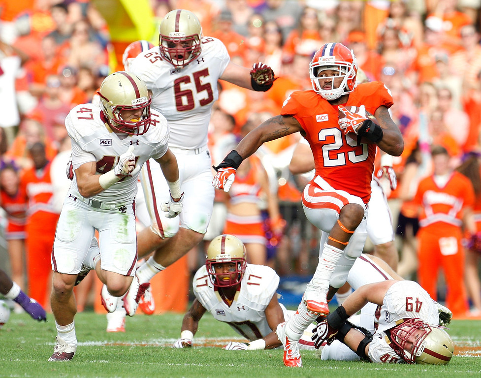 . Roderick McDowell #25 of the Clemson Tigers rushes for a first down during the game against the Boston College Eagles at Memorial Stadium on October 12, 2013 in Clemson, South Carolina. (Photo by Tyler Smith/Getty Images)