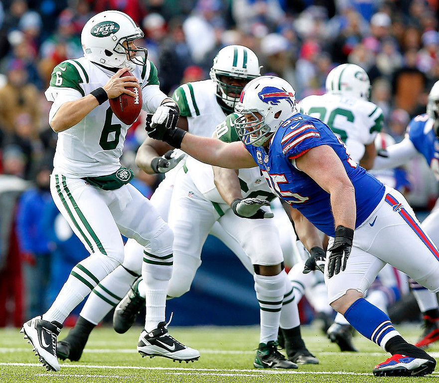 . New York Jets quarterback Mark Sanchez (6) is pressured by Buffalo Bills defensive tackle Kyle Williams (95) during the first half of an NFL football game on Sunday, Dec. 30, 2012, in Orchard Park, N.Y. (AP Photo/Bill Wippert)