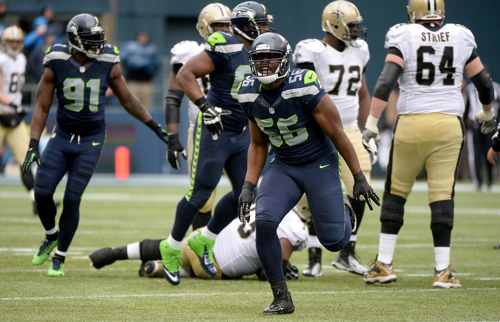 . SEATTLE, WA - JANUARY 11:  Defensive end Cliff Avril #56 of the Seattle Seahawks celebrates after stopping the New Orleans Saints in the third quarter during the NFC Divisional Playoff Game at CenturyLink Field on January 11, 2014 in Seattle, Washington.  (Photo by Harry How/Getty Images)