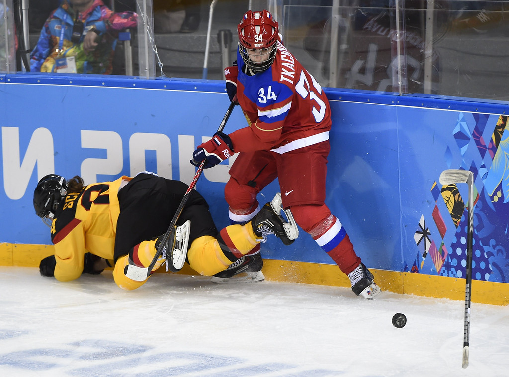 . Germany\'s Lisa Christine Schuster (L) vies with Russia\'s Svetlana Tkachyova during the Women\'s Ice Hockey Group B match between Russia and Germany at the Shayba Arena during the Sochi Winter Olympics on February 9, 2014. JONATHAN NACKSTRAND/AFP/Getty Images