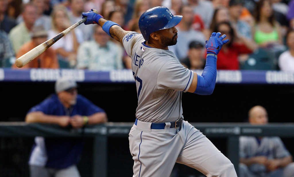 . Los Angeles Dodgers\' Matt Kemp flies out against the Colorado Rockies in the fifth inning of a baseball game in Denver, Thursday, July 4, 2013. (AP Photo/David Zalubowski)