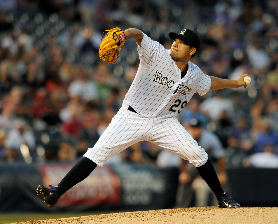 . Colorado Rockies starting pitcher Jorge De La Rosa throws in the fourth inning of a baseball game against the Cincinnati Reds on Thursday, Aug. 14, 2014, in Denver. (AP Photo/Chris Schneider)
