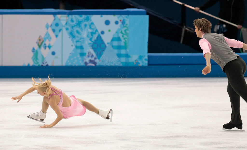 Description of . Stacey Kemp falls as she and David King of Britain compete in the pairs short program figure skating competition at the Iceberg Skating Palace during the 2014 Winter Olympics, Tuesday, Feb. 11, 2014, in Sochi, Russia. (AP Photo/Ivan Sekretarev)