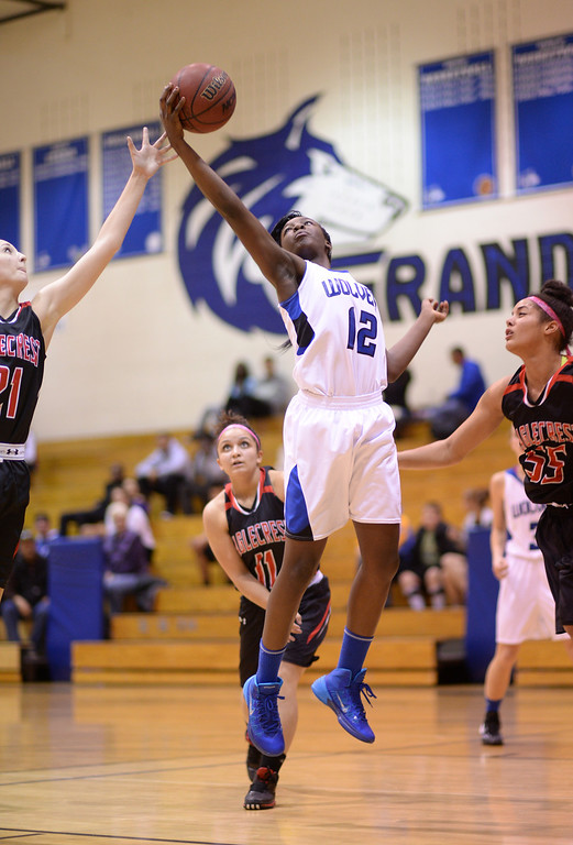 . AURORA, CO. JANUARY 08: Michaela Onyenwere of Grandview High School (12), center, controls the offensive rebound against Eaglecrest High School defense in the 2nd half of the game at Grandview High School in Aurora, Colorado January 8, 2014. Grandview won 69-22. (Photo by Hyoung Chang/The Denver Post)