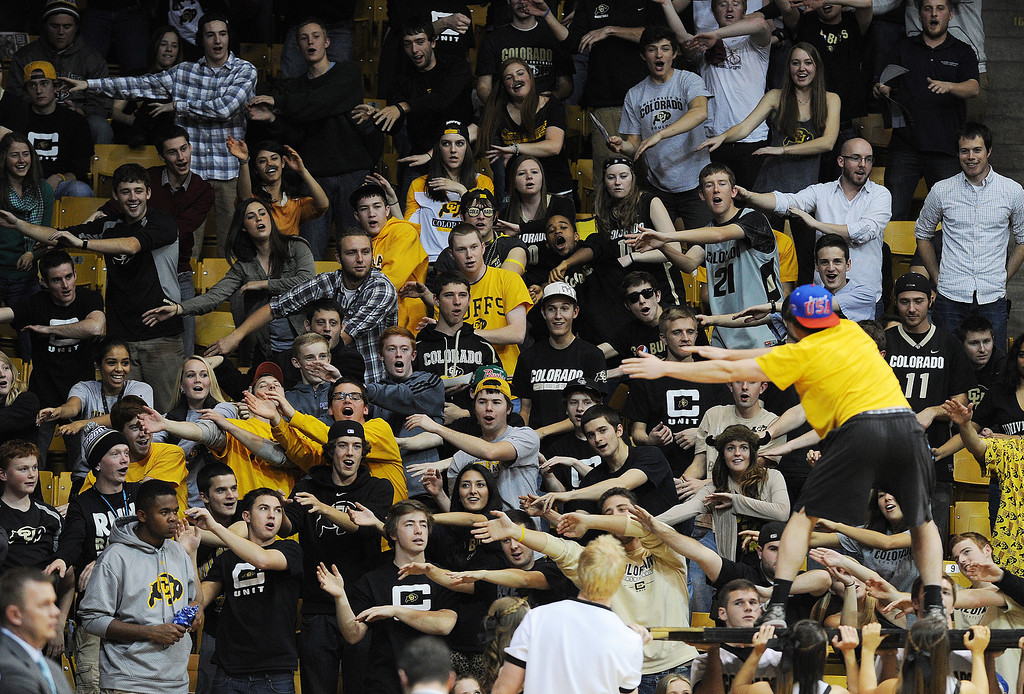 . CU fans do the roller coaster to start the second half of the December 13, 2013 game in Boulder. (Cliff Grassmick/Boulder Daily Camera)
