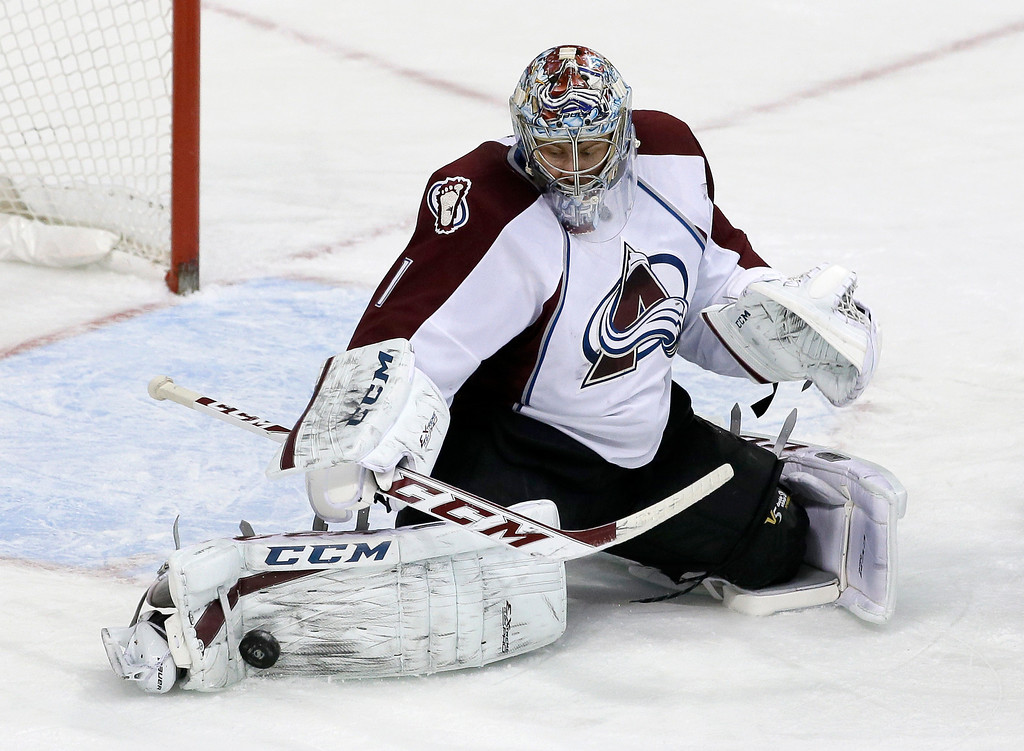 . Colorado Avalanche goalie Semyon Varlamov (1), of Russia, stops a shot from the Dallas Stars in the third period of an NHL hockey game, Monday, Jan. 27, 2014, in Dallas. Varlamov made 41 saves in the 4-3 Avalanche win. (AP Photo/Tony Gutierrez)