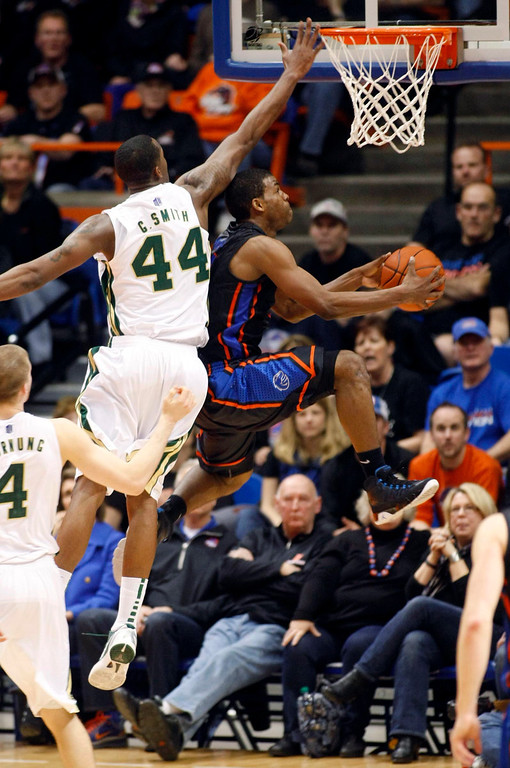 . Boise State guard Derrick Marks (2) scores against Colorado State forward Greg Smith (44) during an NCAA college basketball game in Boise, Idaho, Saturday, March 2, 2013.  (AP Photo/Darin Oswald)