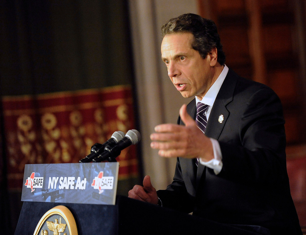 . New York Governor Andrew Cuomo talks about the New York Secure Ammunition and Firearms Enforcement Act in Albany, New York January 15, 2013. Cuomo signed into law one of the nation\'s toughest gun-control measures and the first to be enacted since the mass shooting at an elementary school in neighboring Connecticut. REUTERS/Hans Pennink