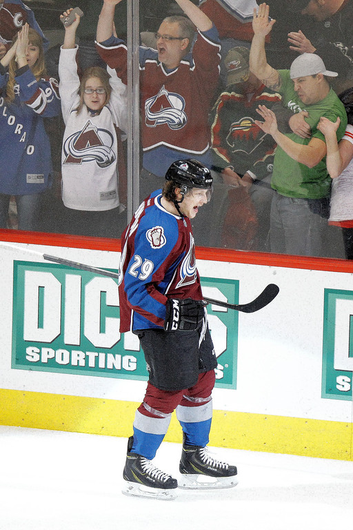 . Colorado Avalanche\'s Nathan MacKinnon (29) celebrates a goal against the Minnesota Wild during the third period of an NHL hockey game on Thursday, Jan. 30, 2014 in Denver. The Avalanche won 5-4. (AP Photo/Barry Gutierrez)