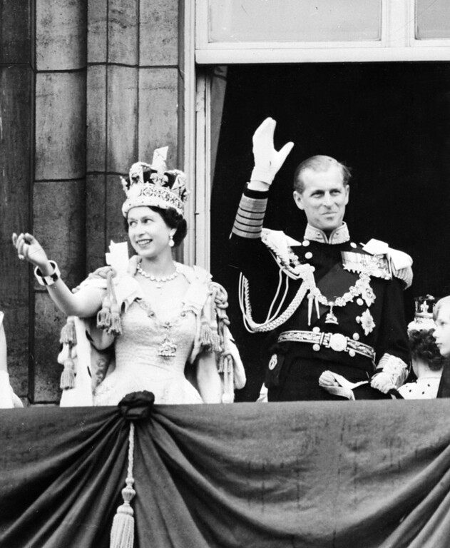 . In this file picture taken on June 2, 1953 Britain\'s Queen Elizabeth II and by Prince Philip, The Duke of Edinburgh wave to the crowds from the balcony at Buckingham Palace following the Coronation ceremony in London.  Queen Elizabeth II marked the 60th anniversary of her coronation on June 4, 2013 with a service at Westminster Abbey filled with references to the rainy day in 1953 when she was crowned.  AFP PHOTO/FILESSTF/AFP/Getty Images