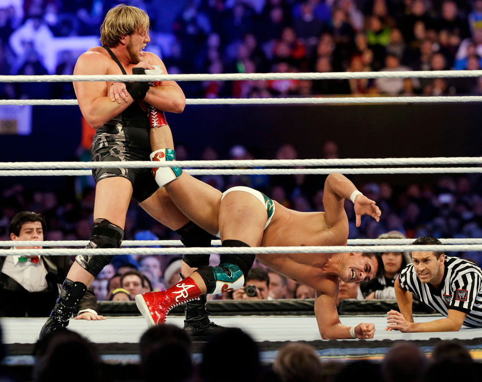 ". Jacob ""Jake\"" Hager, Jr., known as Jack Swagger, left, locks up the leg of Jose Alberto Rodr�guez, of Mexico, known as Alberto Del Rio, during the WWE Wrestlemania 29 wrestling event, Sunday, April 7, 2013, in East Rutherford, N.J. (AP Photo/Mel Evans)"